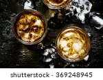 cold whiskey in a glass with... | Shutterstock . vector #369248945