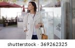 smiling stylish woman walking... | Shutterstock . vector #369262325