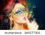 sexy woman with carnival mask.... | Shutterstock . vector #369277301