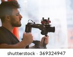 videographer with gimball video slr - stock photo