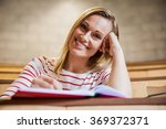 female student taking notes in... | Shutterstock . vector #369372371