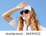 beautiful young girl over blue... | Shutterstock . vector #36939322