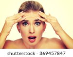 a young woman checking wrinkles ...   Shutterstock . vector #369457847