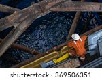 worker at jack up oil rig leg... | Shutterstock . vector #369506351