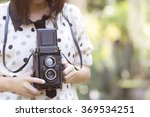 Woman Using Vintage Camera...