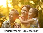 mother with kids on the field | Shutterstock . vector #369550139
