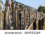Old Wooden Fence With Barbed...
