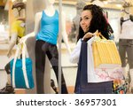 smiling girl with bags stand near - stock photo