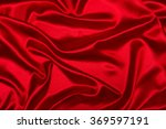 Stock photo sensuous smooth red satin 369597191