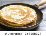 stack of pancakes on a cast... | Shutterstock . vector #369608327