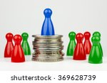 Small photo of Conceptual financial position represented with colored play pieces and coins