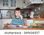 Beautiful Little Boy  Eating...