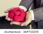 businessman giving a red heart... | Shutterstock . vector #369710255