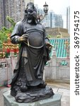 Small photo of Hong Kong, China - June 25, 2014: Chinese Zodiac Bronze Rooster Stature at Sik Sik Yuen Wong Tai Sin Temple