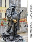 Small photo of Hong Kong, China - June 25, 2014: Chinese Zodiac Bronze Dragon Stature at Sik Sik Yuen Wong Tai Sin Temple