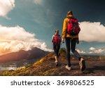 two ladies hikers walking on... | Shutterstock . vector #369806525