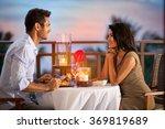 couple sharing romantic sunset ... | Shutterstock . vector #369819689
