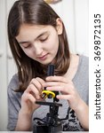 young student with microscope | Shutterstock . vector #369872135