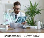 doctor looking x ray of his... | Shutterstock . vector #369944369