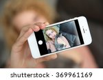 young woman holding smartphone... | Shutterstock . vector #369961169