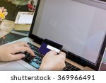 hands  credit card and computer ... | Shutterstock . vector #369966491