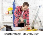 a carpenter drilling hole in... | Shutterstock . vector #369987359