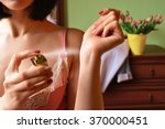 woman puts perfume on. perfume... | Shutterstock . vector #370000451