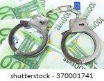 Steel Handcuffs On A Heap Of...