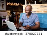 portrait of smiling man with a... | Shutterstock . vector #370027331