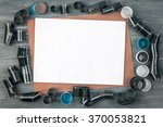 old film with case on wooden... | Shutterstock . vector #370053821