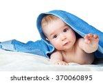 cute baby in a towel | Shutterstock . vector #370060895