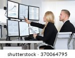 financial workers analyzing... | Shutterstock . vector #370064795