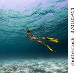 lady swimming underwater over... | Shutterstock . vector #370105451