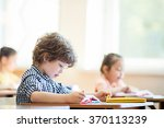 writing boy in classroom | Shutterstock . vector #370113239