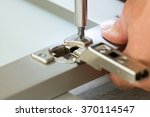 Stock photo adjusting fixing cabinet door hinge 370114547