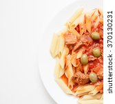 Small photo of Tuna on pasta cooked al dente with olives served on elegant white plate with white table background