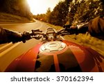 riding motorcycle in the sunset. | Shutterstock . vector #370162394