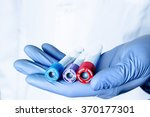 test tubes in hand  palm ... | Shutterstock . vector #370177301