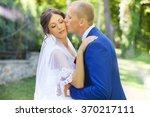the groom kisses the bride on...   Shutterstock . vector #370217111
