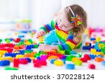 preschooler child playing with... | Shutterstock . vector #370228124