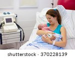 mother giving birth to a baby.... | Shutterstock . vector #370228139