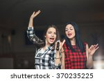 portrait of happy girls singing ... | Shutterstock . vector #370235225