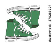 green gym shoes   by hand the... | Shutterstock .eps vector #370289129