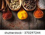 spices. spice in wooden spoon.... | Shutterstock . vector #370297244