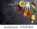 herbs and spices over black... | Shutterstock . vector #370297829