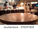 empty wood table top with blur... | Shutterstock . vector #370297835