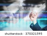 businessman drawing graphs on... | Shutterstock . vector #370321595