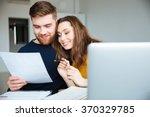 happy beautiful couple managing ... | Shutterstock . vector #370329785