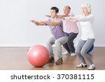 seniors doing squats during... | Shutterstock . vector #370381115