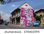 Small photo of BANGKOK, THAILAND - JANUARY 31, 2016: A mural artwork on a building exterior of the Chinese style shophouse by Aitch, a Romanian street artist, which is part of the Bukruk II Urban Arts Festival.
